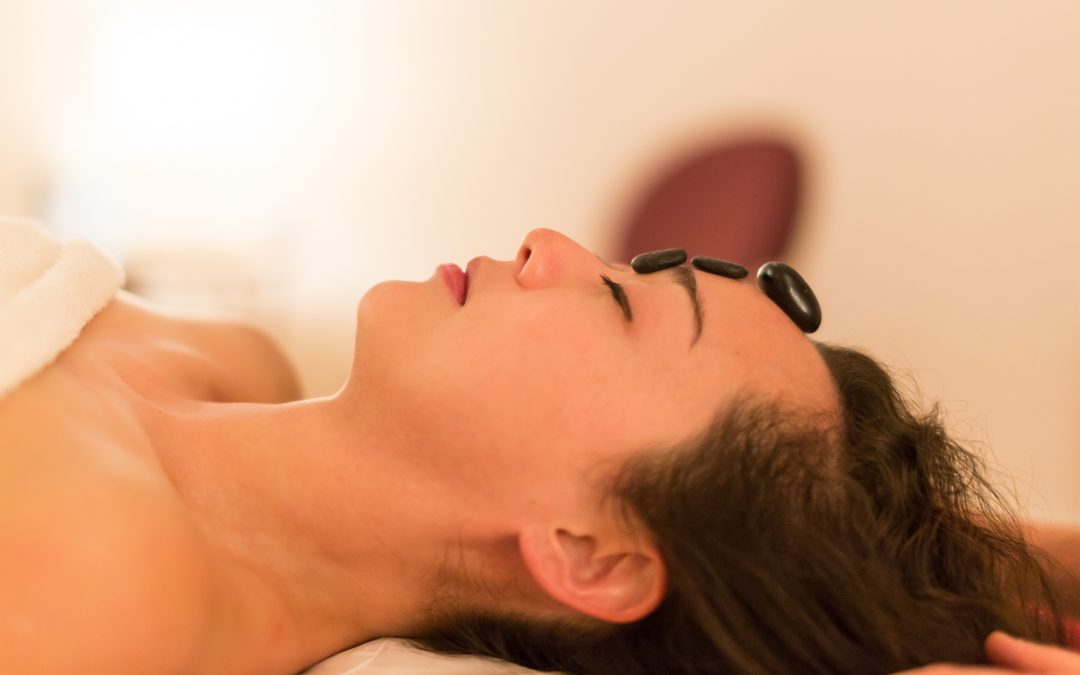 Hot-stone and aromatherapy massage for migraine
